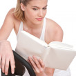 Fitness series - Woman reading book - Stock Photo