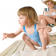 Beach - Mother with child playing with toys in sand — Stock Photo #4682951