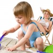 Beach - Mother with child playing with toys in sand — Stock Photo #4682953