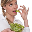 Stock Photo: Healthy lifestyle series - Womeating kiwi
