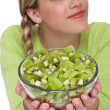 Healthy lifestyle series - Woman holding bowl with kiwi — Stock Photo