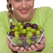 Healthy lifestyle series - Woman holding bowl of grapes — Stock Photo #4683021