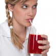 Healthy lifestyle series - Woman drinking tomato juice — Stock Photo