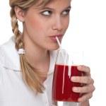 Healthy lifestyle series - Woman drinking tomato juice — Stock Photo #4683064