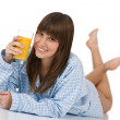 Female teenager with healthy orange juice — Stock Photo #4683102