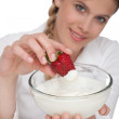 Healthy lifestyle series - Woman with strawberry and yogurt — Stock Photo