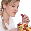 Healthy lifestyle series - Woman holding strawberry — Stock Photo #4683237