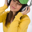 Happy female teenager enjoy music — Stock Photo
