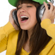 Stock Photo: Happy female teenager enjoy music with headphones