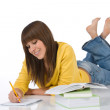 Happy female teenager write homework — Stok fotoğraf