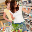 Shopping series - Beautiful brunette in a supermarket — Stock Photo