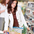 Shopping series - Beautiful brunette in cosmetics department — Foto Stock