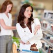 Shopping series - Attractive woman in cosmetics department — Stock Photo