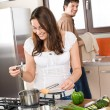 Young couple cook in modern kitchen — Stock Photo