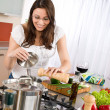 Cooking - Happy woman cook in modern kitchen — Stock Photo