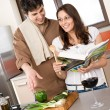 Smiling couple in modern kitchen cook together - Foto Stock