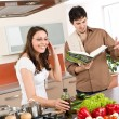 Royalty-Free Stock Photo: Happy couple cook in kitchen with cookbook