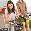 Royalty-Free Stock Photo: Young couple cooking together in modern kitchen