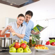 Royalty-Free Stock Photo: Young happy couple cook in kitchen with cookbook