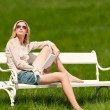 Stock Photo: Spring and summer - Young woman relaxing in meadow