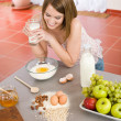 Baking - Happy woman prepare healthy ingredients - Stock Photo