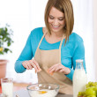 Baking - Smiling woman with healthy ingredients — Stock Photo