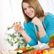 Cooking - Smiling woman with glass of white wine — Stock Photo #4683737