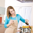 Cooking - Young woman with spaghetti on stove — Stock Photo #4683758