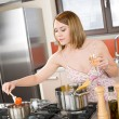 Attractive woman cooking spaghetti and tomato sauce — Stock Photo