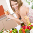 Cooking - smiling woman with glass of white wine and vegetable — Stock Photo #4683789