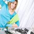 Tired woman cleaning kitchen with brush - Foto de Stock