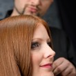 Professional hairdresser with fashion model at luxury salon — Stock Photo #4683843