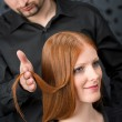 Professional hairdresser with fashion model at luxury salon — Stock Photo #4683862