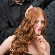 Professional hairdresser with fashion model at luxury salon - Stock fotografie