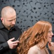 Professional hairdresser with fashion model at luxury salon — Stock Photo #4683886