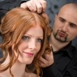 Professional hairdresser with fashion model at luxury salon - Stock Photo