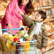 Grocery store shopping - Womwith child — Zdjęcie stockowe #4684171