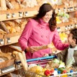 Grocery store shopping - Young woman with child — Stock Photo #4684175