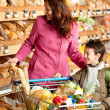 Grocery store shopping - Woman with child — Stock Photo #4684176