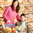 Grocery store shopping - Happy woman and child — Stock Photo #4684186