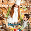 Grocery store shopping - Red hair woman with child — Stock Photo #4684188