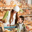 Grocery store shopping - Red hair woman with child - Lizenzfreies Foto