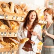 Grocery store: Two women choosing bread - Lizenzfreies Foto