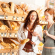 Grocery store: Two women choosing bread - Photo
