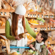 Grocery store shopping - Red hair woman with little boy - Lizenzfreies Foto