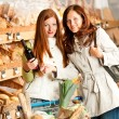 Stock Photo: Grocery store: Two young women