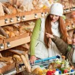 Grocery store shopping - Red hair woman with little boy — Stock Photo