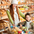 Grocery store shopping - Long red hair woman with little boy — Stock Photo