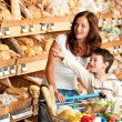 Grocery store shopping - Womwith child in supermarket — Stok Fotoğraf #4684256