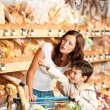 Grocery store shopping - Mother with child — Stock Photo